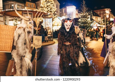 Graz, Austria - December 2017: Krampus masked People in Graz at a Krampus Festival parade for advent before Christmas