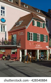 GRAZ, AUSTRIA -DECEMBER 6, 2013 - ourists enjoy the winter sun in front of the cafe on the street of Graz