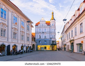 Graz, Austria - February 16, 2019: People and tourists at Haus des Horens on Mariahilferstrasse Street in Downtown and Old city of Graz in Austria. Town in Styria in Europe. Travel and history