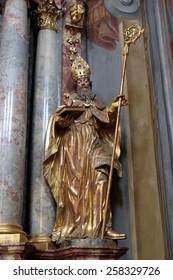 GRAZ, AUSTRIA - JANUARY 10, 2015: Saint Augustine, altar of Saint John of God in Barmherzigenkirche church in Graz, Styria, Austria on January 10, 2015.