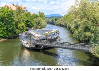 """Graz, Austria - July 19, 2019: Island in the Mur - Murinsel is an artificial floating """"island"""" in the middle of the Mur River and connects two banks on both sides"""