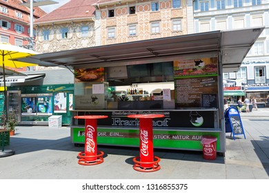 GRAZ, AUSTRIA - JULY 2018 : Austrian fast food shop, sausage stand in Graz, Austria on July 20, 2018. It's called Schnellimbiss in German language