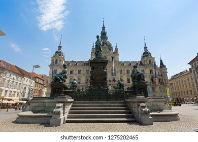GRAZ, AUSTRIA - JULY 2018 : Erzherzog Johann fountain at Hauptplatz square in front of Town hall in Graz, Austria on July 20, 2018