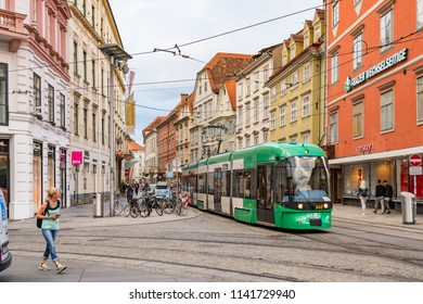 GRAZ, AUSTRIA - JULY 21, 2018: Tram arriving at the Main Square of Graz in the historic city center from the direction of Sackstrasse