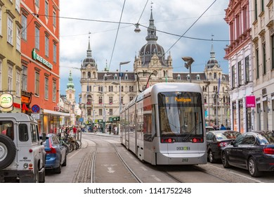 GRAZ, AUSTRIA - JULY 21, 2018: Tram number 5 arriving at the Main Square of Graz in the historic city center from the direction of Murgasse