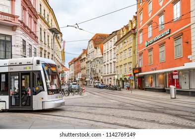 GRAZ, AUSTRIA - JULY 21, 2018: Tram arriving at the Main Square of Graz in the historic city center from the direction of Murgasse