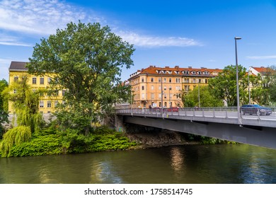 Graz, Austria - June 16, 2020 - bridge over the river Mur with traditional Austrian houses and trees