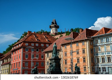 GRAZ/ AUSTRIA JUNE 2018: Painted facades and the Clock Tower in the old town of Graz, Austria are on UNESCO World Cultural Heritage list