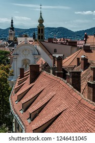 GRAZ/ AUSTRIA JUNE 2018 - View of the old town center of Graz with the church Dreifaltigkeitskirche in the middle from the staircase of Castle Schlossberg Hill. Graz, Austria.