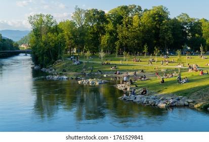Graz, Austria - June 22, 2020 - people in the Augarten park on the banks of the river Mur in Graz, Austria