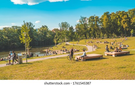 Graz, Austria - June 22, 2020 - people relaxing and sunbathing in the Augarten park on the banks of the river Mur