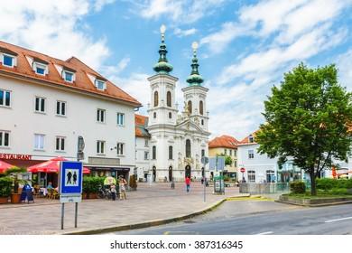 GRAZ, AUSTRIA- MAY 30, 2015: Buildings and street around Mariahilf church in Graz, Styria, Austria.