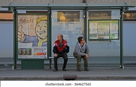 GRAZ, AUSTRIA - NOVEMBER 14, 2015: 2  men are waiting transport at the bus stop