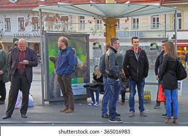 GRAZ, AUSTRIA - NOVEMBER 14, 2015: people are communicating on the street in Graz, Austria