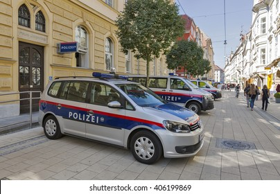 GRAZ, AUSTRIA - SEPTEMBER 11, 2015: Unrecognized people walk along Schmiedgasse street and local police station in Graz Old Town. Graz is the capital of Styria and second largest city in Austria.