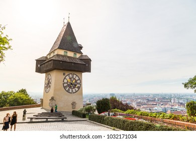 GRAZ, AUSTRIA - SEPTEMBER 16, 2016 : Medieval clock tower Uhrtrum in Schlossberg Castle and old town cityscape aerial view from Schlossberg Hill, Styria region of Austria.