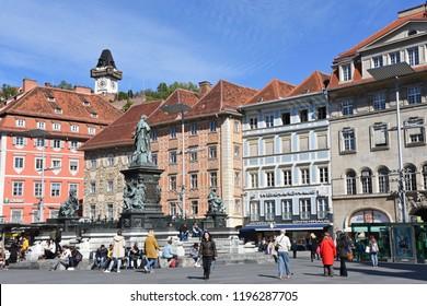Graz, Austria - September 26, 2018: Hauptplatz, Archduke Johann Fountain and Uhrturm