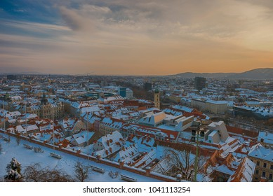 Graz City Aerial view in winter during Sunset.