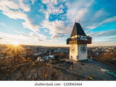 Graz city landmark Schlossberg park tower at sunset and city panorama