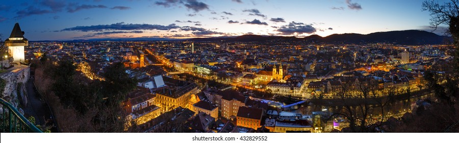 Graz city night top view with illuminated buildings (Austria). Panorama.