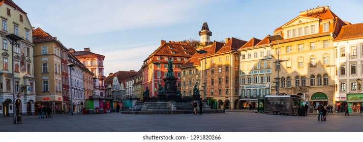 Graz, Styria / Austria - 20.01.2019: Panorama, Statue fountain in front of the town hall in Graz, Austria Painted facades and the Clock Tower in the old town of Graz, Austria Travel destination.