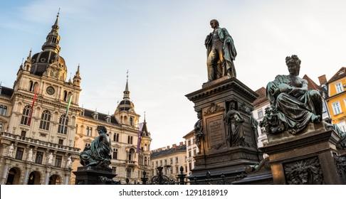 Graz, Styria / Austria - 20.01.2019: Statue fountain in front of the town hall in Graz, Austria Painted facades in the old town of Graz, Austria Travel destination.