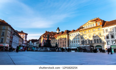 Graz, Styria / Austria - 20.01.2019: Statue fountain in front of the town hall in Graz, Austria Painted facades and the Clock Tower in the old town of Graz, Austria Travel destination.