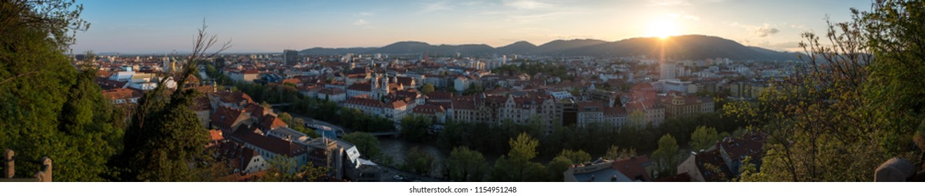 Graz, Styria, Austria - April 4th, 2018: panoramic view over city center of Graz in Austria with river Mur, seen from Mt.Schloßberg