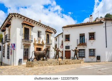 GRAZALEMA, SPAIN - MAY 12, 2018: Street with white houses in Grazalema mountain village, Andalusia, Spain. This place is located in National Park and is popular tourist destination.