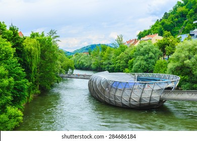 GRAZ,AUSTRIA- MAY30: The artificial island on the Mur river in Graz on May 30, 2015 in spring time.It is a famous landmark and called Murinsel, very popular for Graz tourism.