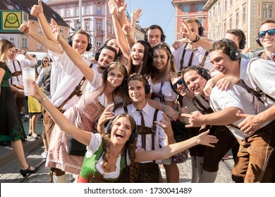 Graz/Austria - Sep.2019: annual autumn festival of Styrian folk culture (Aufsteirern). Group of cheerful beautiful young people in bright national costumes posing for photo during traditional festival
