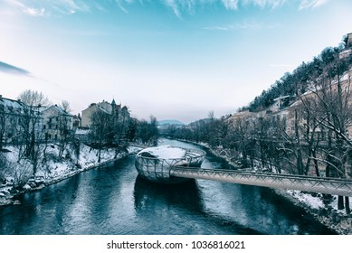 GRAZ,AUSTRIA-February 25:An artificial island on the Mur river in Graz in Winter on February 25,2018.It is a famous landmark and called Murinsel.