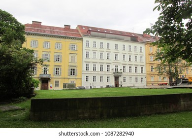Graz,Austria-May 5,2018:Beautiful landscape view of amazing green garden with yellow buildings in the city of Graz,the capital of Styria,Graz, Austria