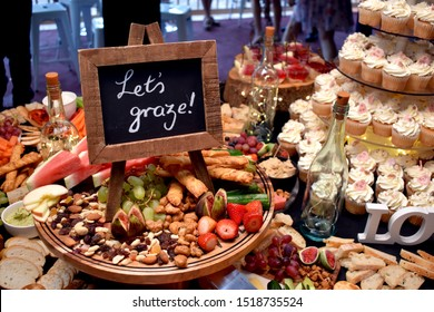 Grazing table at a party with sign
