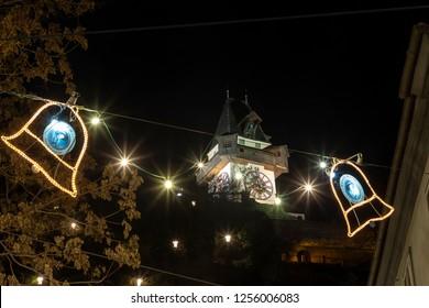 Graz,Styria,Austria-December 10,2018 : christmas time in graz,christmassy illuminated schlossberg hill with clocktower uhrturm  in the capital of styria,austria.