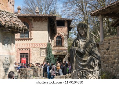 Grazzano Visconti,Italy-April 2,2018:People visit the historical village of Grazzano Visconti,neo-gothic village near Piacenza, Italy during a sunny day