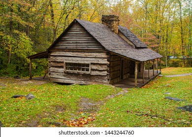 Grear Smoky Mountains National Park, Tennessee - an historic log home in a hardwood forest in the autumn season