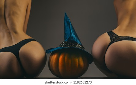 Great ass and pumpkin. Advertisement concept. Sexy pumpkin butt. Halloween Party girls. Pumpkin head jack lantern. Trick or treat