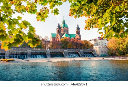 Great autumn view of Landmark Protestant St. Luke's Church. Bright morning cityscape of Munich, Bavaria, Germany, Europe. Traveling concept background.