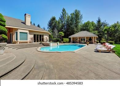 Great backyard with swimming pool in American Suburban luxury house. Northwest, USA