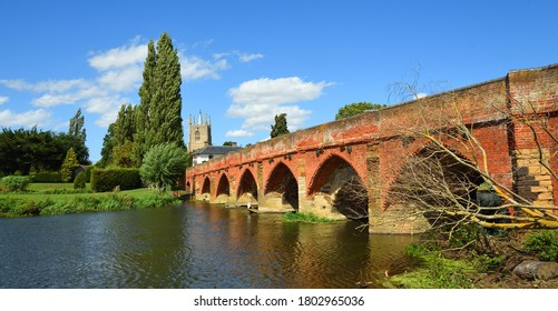 Great Barford Packhorse Bridge and Church Bedfordshire England.