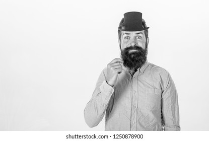 Great to be smart but intelligence is hard thing to pin down. Guaranteed ways appear smarter than you are. Man bearded hipster hold cardboard top hat to look smarter and serious on white background.