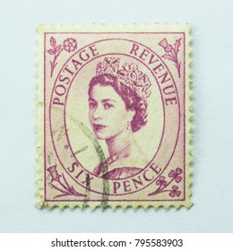 Great Britain - CIRCA 1955 - Vintage Postage Revenue six pence Commonwealth stamp features Queen Elizabeth II
