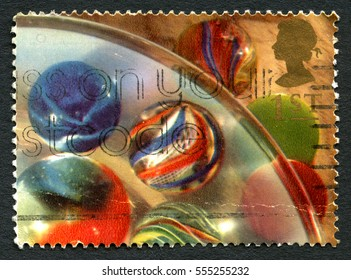 GREAT BRITAIN - CIRCA 1992: A used postage stamp from the UK, depicting an image of various coloured Marbles, circa 1992.