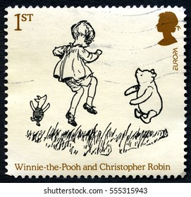 GREAT BRITAIN - CIRCA 2010: A used postage stamp from the UK, depicting an illustration of Winnie the Pooh and Christopher Robin, circa 2010.