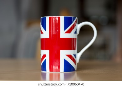 A Great Britain flag on a mug close up with blurry background