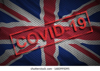 Great britain flag and red Covid-19 stamp. Coronavirus 2019-nCov outbreak