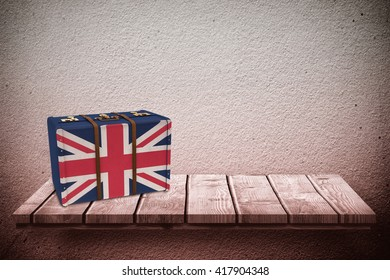 Great Britain flag suitcase against wooden shelf