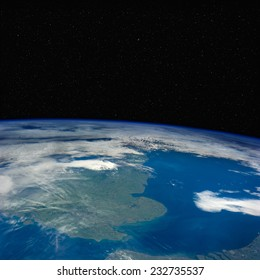 Great Britain from space with stars above. Elements of this image furnished by NASA.