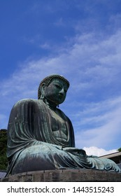The Great Buddha of Kamakura is an outdoor bronze statue of Amida Buddha under blue sky located on the grounds of Kotoku-in Temple in Kanagawa Prefecture Japan. Kamakura Daibutsu Statue.